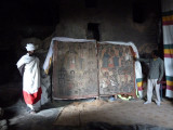 Cave church painting, priest and Lalibela guide