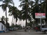 The palm-lined main drag of Barra de Potosí