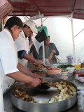 We frequently sat down on stools to eat lunch at street vendor shops - tacos!