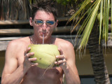 Norman sipped the sweet coconut milk