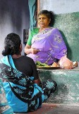 Diviner informing a client what the Gods foresee for her life. Tirunelveli District, Tamil Nadu.