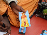 Fortune teller in Nagercoil, Tamil Nadu. The main card shows Saraswati, goddess of knowledge, music and creative arts.