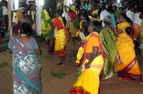 Women dancing in front of the Amman temple during the Mulaipari festival at Koovathupatti Tamil Nadu.
