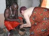 Me and fetish priest Mensah Gakli. You have to change clothes and wash your hands and arms inside the shrine.