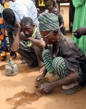 Libation. Alcohol for the ancestors.