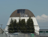 The beginning of the shedding of Hangar One