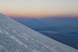 The mountain shadow is forming, here it is above the horizon still.