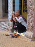 OLD MAN ON TEMPLE STEPS