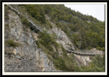 The Answer would be to build a road along the Cliff Face!!!