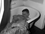 Paul Willis sleeping it off in Rose's bath tub.