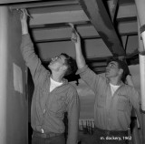 Two sailors painting aboard the USS Hugh Purvis DD 709