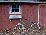 Bicycle Against Barn Wall
