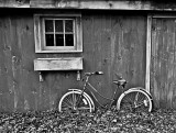 Bicycle Against Barn