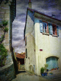 The house with the blue flowerpots