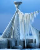 A surrealistic gigantic praying mantis of ice…