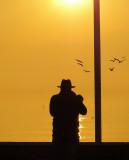 A photographer at sunrise....