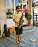 The saxophonist with sandals