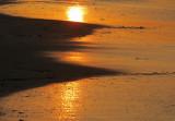 reflet solaire sur le sable