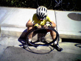 Sandra very intent on fixing her flat! March 29 2004
