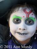 Little girl painted as calavera