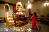 Lady praying to Our Lady of Guadalupe