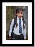 A School Girl Waiting for School Bus