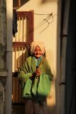 Patan old woman Namaste.jpg