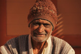 Patan man with hat.jpg