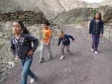 Kara, Rahil, Darragh, and Sophie skipping down to the beach