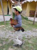 Rahil proudly carrying the hen