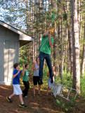 Ro falling off the zipline ladder