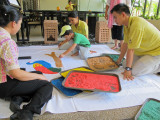 Preparing rangoli with the Rasa Ria staff on Diwali