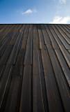 The tarred wooden walls of the new art museum Artipelag