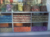 Candy shop in Adana.  The turban-shapes are a solid mass of nuts and jelly-rollup-like filling.