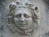 A lady's face at one end of the sarcophagus