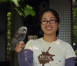 Michelle gets the tour and holds Bella our educational saw whet owl