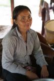 Woman in village, preparing rattan