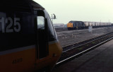 Class 43 013 at Darlington, while a Class 37 by-passes the station 1987.
