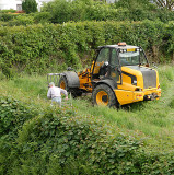 Clearing the field over the hedge from our house.