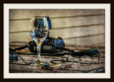 A Wine Glass. Reading Glasses & A Camera