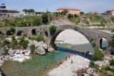 Albanians enjoying the clear water beneath the bridge