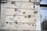 Bullet holes scarring a façade