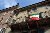 Italian flags hanging from a balcony, Verona
