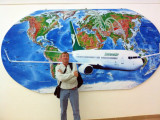 Me at Dashoguz Airport in front of a map of the Turkmenistan Airlines route structure