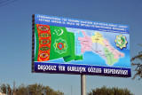 Billboard with Turkmenistan flag and map showing the 5 regions