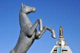 Statue of a rearing horse in a park along Türkmenbaşy şaýoly