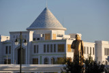The new Dashoguz History Museum behind a statue of Turkmenbashy