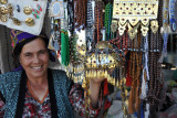 Woman selling traditional jewelry at the Türkmenabat Bazar