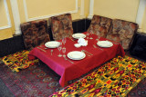 Traditional seating at a restaurant in Türkmenabat