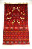 Turkmen carpet with horses and men